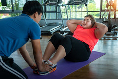 Asian fat girl and her trainer sit up togather in fitness club (I love landscape) Tags: work teach care help action strength train coach power lifting tired diet fitness abs instructor muscle asia asian thai out burn fat sport workout health trainer exercise woman gym girl weight female fit body overweight indoor person active club obese big healthy lifestyle calories training fatburning athlete beautiful people man