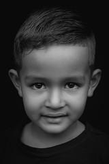 DSCF1665-4 (YouOnFoto) Tags: boy jongen black white zwart wit closeup dichtbij natuurlijk licht natural light shadow schaduw portret portrait kids kinderen fujifilm face gezich eyes ogen