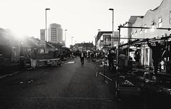 Market sunset (S Clark) Tags: ridleyroad ridleyroadmarket eastlondon hackney market street streetstories streetlife streetphotography londonstreet london londonlife urban sunset ricohgrii ricohgr londonist dalston blackandwhite monochrome