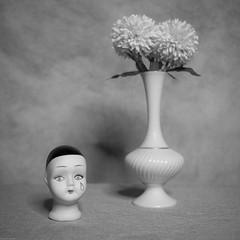 Porcelain Doll Head and Vase with Flowers (DayBreak.Images) Tags: tabletop stilllife porcelain doll head vase flowers canondslr zenit lomography neptune thalassa 35mm ringlight lightroom bw