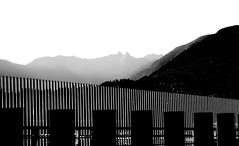 Safety fencing, lines, harbour, mountains: HFF! (+1) (peggyhr) Tags: peggyhr hff lines railings diagonal verticals monochrome thelions dsc08978az vancouver bc canada infinitexposurel1 artofimages~aoil1~ aoi visionaryartsgallerylevel1 frameit~level01~ thelooklevel3orange frameit~level02~ thelooklevel5green 50faves