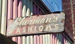 Shermans Fashions sign (dwheel41) Tags: sign signs roadside faded old wooden fashions decayed