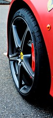 Ferrari wheel cropped (Torquemada1965) Tags: wood parking preselectcom peugot mini mclaren karl ludwig bmw z4 mottoguzzi ferrari honda cb750 alfaromeo 8c westkapelle dike diggerworker