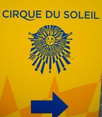 Cirque De Soleil that way (earthdog) Tags: 2010 nikoncoolpixs220 nikon coolpix s220 word sign text arrow cirque de soleil that way cirquedesoleil outdoor sanjose sun logo fence