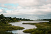 Serpentine and Silver Slough Cove (John Piekos) Tags: grass autumn silver d750 marthasvineyard peaceful water edgartown fall september clouds cool edgartowngreatpond nikon cove serpentine boathouse sloughcove
