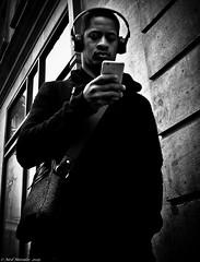 Hip-Hop-Shot (Neil. Moralee) Tags: neilmoralee oxfordneilmoralee man lpov headphones music phone iphone bag shoulder dark hip shot lowpointofview black white bw blackandwhite mono monochrome street candid blackwhite neil moralee nikon d7200 oxford uk wall walk outdoor