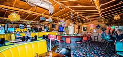 2019 - Road Trip - 135 - Great Falls - 25 - O'Hare Motor Inn - Sip 'n Dip Lounge (Ted's photos - For Me & You) Tags: 2019 cropped greatfalls montana tedmcgrath tedsphotos usa vignetting sipndiplounge greatfallssipndiplounge sipndiploungegreatfalls ohairemotorinn greatfallsohairemotorinn ohairemotorinngreatfalls oharemotorinnsipndiplounge sipndiploungeoharemotorinn tikibar sipndiptikibar tacky tackylounge bar lounge cocktaillounge polynesianbar polynesianlounge seating seats bambooceiling kitsch kitschy loungeseating colorful colourful stools barstools barseats booths loungebooths barbooths barcustomers loungecustomers yellow