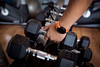 hand with a smart watch lift a dumbbell from roll of sumbbells (I love landscape) Tags: smartwatch fit man up interior steel mass building freeweights dumbbells row sports weights weightlift iron lift black dumbbell weight people closeup bodybuilding gym healthy background workout weightlifting lifestyle heavy health equipment metal shape hand power club muscle lifting fitness body barbell training exercise strength activity strong male sport adult person
