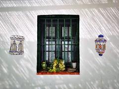 Molinos restaurant, Lagos. (Ian, Bucks) Tags: window lights lamps wall bars spain day sunny shade shadows plants