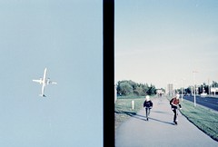 street2019. tallinn. (Yaroslav F.) Tags: tallinn 35mm airplane halfframe half frame kids road photography sky yaroslav futymskyi travel lifestyle estonia kodak vision 3 500t ecn2 process lomography strange colour scooter