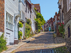 Mermaid Street, Rye, Sussex (Ray in Manila) Tags: rye pretty touristy historical smugglers street england white sussex colours unitedkingdom tudor cobblestone mermaidstreet mermaidinn cinqueport eos650d house inn british summer sky heritage architecture town cottage medieval cobble picturesque oldtown iconic eastsussex oldbuilding weald timberedhouse quintessentiallybritish