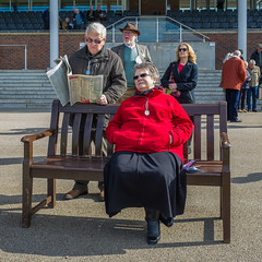 Wetherby Races 010 (Peter.Bartlett) Tags: peterbartlett man woman couple candid uk bench people unitedkingdom newspaper streetphotography sitting ricohgr westyorkshire reading wetherby england