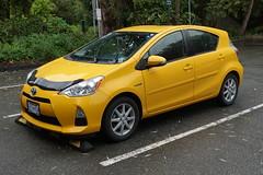 2014 Toyota Prius C (D70) Tags: 2014 toyota prius c priusc hybrid electric car yellow burnaby britishcolumbia canada sony dscrx100m5