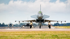 Coningsby Typhoons. (spencer_wilmot) Tags: raf royalairforce typhoon tiffy canards militaryaviation combataircraft fighter fighterjet coningsby aviation aircraft airplane arrival apron airforce ramp runway plane pan jet clouds qcy egxc headon landing recovery taxiway twin