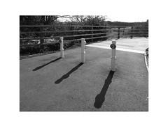 gnomons (chrisinplymouth) Tags: bollard black white monochrome shadow plymstock diagonal perspective plymouth devon england trait uk city xg cw69x cameo cyclepath gnomon r235 diag