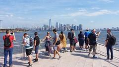 New York Skyline from Liberty Island (dirklie65) Tags: woman man libertyisland menschen people manhattan skyline newyork
