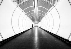 Tube (CoolMcFlash) Tags: tube vienna architecture station person street city urban streetphotography canon eos 60d symmetry gangway röhre durchgang wien architektur strase stadt symmetrie fotografie photography bw bnw monochrome blackandwhite schwarzweis sw sigma 1020mm 35 wienerlinien subway ubahn