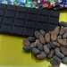 Dark chocolate from the Belgian brand Bianca, on display with cocoa beans