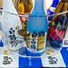 Hakutsuru Sake verschiedene Flaschen in einem Eisbehälter