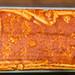 Pizza in der Zubereitung - Ausgerollter Teig mit Tomatensauce