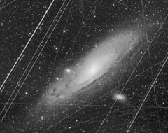 The Andromeda Galaxy in a Crowded Sky (kees scherer) Tags: andromeda m31 messier 31 cosmic radiation satellite airplane trails astro apod astronomy picture day nasa