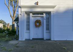 Doorway — Owingsville, Kentucky (Pythaglio) Tags: house dwelling residence historic twostory twobay sidepassage vinylsiding bracedframe exteriorchimney 44windows altered sidewalk trabeateddoorway sidelights cornice entablature pilasters owingsville kentucky bathcounty greekrevival