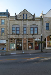 Building — Mount Sterling, Kentucky (Pythaglio) Tags: building structure historic commercial twostory stone romanesque rusticated threebay 1891 11windows segmentalarched storefront sidewalk street finials pilasters