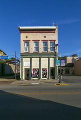 Building — Mount Sterling, Kentucky (Pythaglio) Tags: building structure historic commercial twostory brick fourbay leaning storefront pilasters sidewalk street shadows kentucky montgomerycounty mountsterling 11windows stone lintels sills