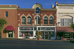 Building — Mount Sterling, Kentucky (Pythaglio) Tags: building structure commercial historic twostory brick storefronts romanesque ornate corbelling corbelled pilasters 11windows roundarched stone stonework voussoirs rusticated capitals kentucky montgomerycounty mountsterling sidewalk street