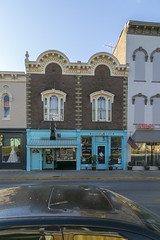 Building — Mount Sterling, Kentucky (Pythaglio) Tags: building structure historic commercial twobay brick ornate italianate twostory roundarched cornice dentils brackets quoins segmentalarched windows tripartite hoodmolds storefronts sidewalk street kentucky montgomerycounty mountsterling