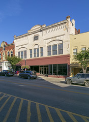 Building — Mount Sterling, Kentucky (Pythaglio) Tags: building structure historic commercial threebay romanesque vacant storefront sidewalk street cars kentucky montgomerycounty mountsterling brick corbelling corbelled finials 11windows segmentalarched