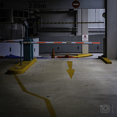 Entrance - Singapore (Paul Perton) Tags: fuji singapore xpro2 zeiss35mmf14distagon exit garage parking street streetphotography urban yellow
