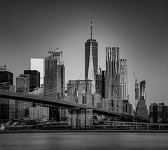 Steel and Concrete Jungle... (Aleem Yousaf) Tags: travel nikon d850 nikkor big apple nyc new york usa united states america city cityscape photography walk building downtown lights shadows september 2019 skyscraper east river digital camera world flickr architecture modern steel glass concrete morning glow 70200 telephoto lee neutral density filter little stopper soft graduated lower manhattan financial district brooklyn bridge park dumbo pebbles beach mono black white silver monochrome trade centre