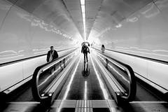 Kick Push Coast (Douguerreotype) Tags: people monochrome underground urban barcelona symmetry blackandwhite catalunya spain mono city tunnel silhouette subway metro bw tube station