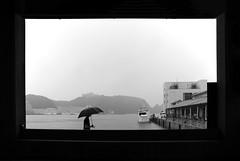 (cherco) Tags: japan japon umbrella monochrome man sea mar boat kumano kiikatsuura silhouette solitario solitary silueta street rain lonely light loner sky frame framing port blackandwhite blancoynegro square mountain perspective window