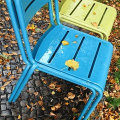 unmistakeably autumnal (vertblu) Tags: chairs stacked stackedchairs stackingchairs rain rainy rainyday wet leaves fallenleaves fallendown pavement autumn fall blue green badweather bsquare 500x500 kwadrat vertblu diagonal sittingaccomodation seatingaccomodation seat colourful colours outdoorfurniture autumnal