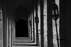 Leçon de Ténèbres (Jean-Luc Léopoldi) Tags: bw noiretblanc mystère cloitre lanternes obscurité darkness piliers