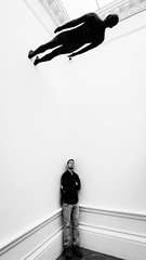 He's Above You (Sean Batten) Tags: london england unitedkingdom royalacademy candid artgallery gallery antonygormley blackandwhite bw person wall nikon d800 1424