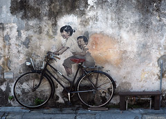 Children On Bicycle (peterphotographic) Tags: p7240493edwm childrenonbicycle ernestzacharevic zacharevic olympus em5mk2 microfourthirds mft ©peterhall georgetown penang malaysia seasia asia street streetphotography streetart bicycle bike graffitti art artist installation pavement mural