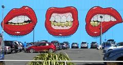 Christchurch - Still Smiling (zorro1945) Tags: christchurch southisland nz newzealand sign mouths lips redlips teeth smiles carpark cars flickertravelaward art streetart mural
