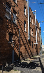 Alley Shadows (tim.perdue) Tags: newark ohio small town downtown square city urban decay street alley building licking county courthouse nikon d5600 nikkor 18140mm detail sign store storefront shop