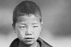 little fighter (Rajiv Lather) Tags: little fighter bhutan bruises scratches bruiser boy portrait eyes stare angry image photograph monochrome blackandwhite bw face fights brawls