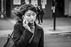 On Hold (Leanne Boulton) Tags: urban street candid portrait portraiture streetphotography candidstreetphotography candidportrait streetportrait streetlife woman female girl face eyes expression mood emotion feeling smartphone mobile phone technology communication hair wind windy breeze flowing tone texture detail depthoffield bokeh naturallight outdoor light shade city scene human life living humanity society culture lifestyle people canon canon5dmkiii 70mm ef2470mmf28liiusm black white blackwhite bw mono blackandwhite monochrome glasgow scotland uk