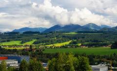 The Alps near Salzburg, Austria (t.beckey) Tags: alps mountains salzburg austria danuveriver cruise scenic europe trees village clouds