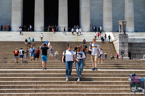 Tourists on the stairs of the Lincoln Memorial