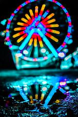 fiestas! (7isaac8) Tags: lights fair d3300 d3400 depthoffield dark darkness focus f12 f14 photographer photography rain railway bokeh bokehlicious bokehful blur bokehballs beautiful beyondbokeh bokehs nikon night nightscape nightscene city cityscape