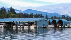Boathouses (oxfordblues84) Tags: vancouver thecityofvancouver vancouverbc vancouverbritishcolumbia britishcolumbia sky cloud clouds cloudy architecture building buildings boat boats boathouses boathouse tree trees mountain royalvancouveryachtclub canada