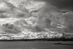 Troubled waters (L@nce (ランス)) Tags: cloud clouds cloudy bw monochrome nikon salish sea ocean pacific juandefuca victoria harbour ogdenpoint breakwater ship coastguard nikkor jamesbay britishcolumbia canada