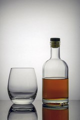 (vladimirfeofanov) Tags: beautiful glassbottle withcognac or whiskey well lit backgroundstands nextto glass boredom propensity alcoholism kit loneliness melancholy drunkenness open notfull