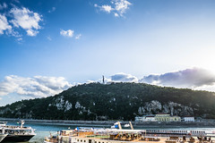 View of Citadella (BirthofSamuel) Tags: hill citadella statue monument history culture budapest hungary sunny scenic green danuberiver boat clouds bluesky sonyalpha sigma16mm14 sigmalens a6000 a6000photography photography picturesque woman torch landmark blue river boats